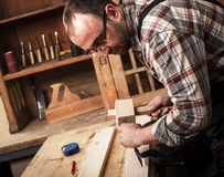 Carpenter working in his workshop Royalty Free Stock Image