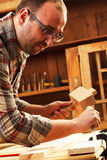 Carpenter working in his workshop Royalty Free Stock Photos