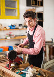 Carpenter working on manual lathe Royalty Free Stock Photography