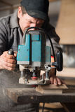 Carpenter working of manual milling machine Royalty Free Stock Photography