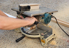 Carpenter working with the miter saw Royalty Free Stock Photo
