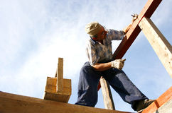 Carpenter working with nails and a box of tools Stock Images