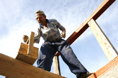 Carpenter working with nails and a wooden box  Royalty Free Stock Photo
