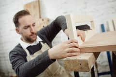 Carpenter is working on new wooden product. stock image