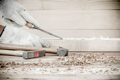 Carpenter working with old plane Stock Photography