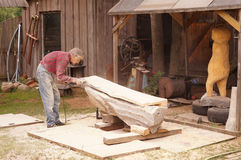 Carpenter working outside on wooden part Stock Photo