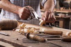 Carpenter working with plane stock photos