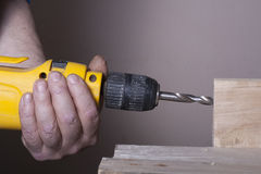 Carpenter working with plane on wooden background at Building Site. Joiner workplace Royalty Free Stock Photos