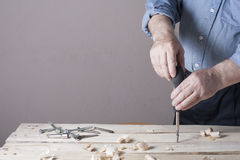 Carpenter working with plane on wooden background at Building Site. Joiner workplace Royalty Free Stock Photography