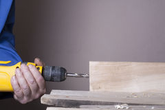Carpenter working with plane on wooden background at Building Site. Joiner workplace Stock Images
