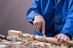 Carpenter working with plane on wooden background at Building Site. Joiner workplace. Royalty Free Stock Photos