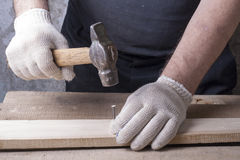 Carpenter working with plane on wooden background at Building Site. workplace Stock Photo