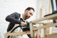 Carpenter is working with plane Stock Images