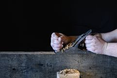 Carpenter working with a planer Stock Photos