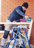 Carpenter Working Polishing Machine Royalty Free Stock Photos