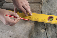 Carpenter working on the production. Of decorative detail, close up photo Stock Image