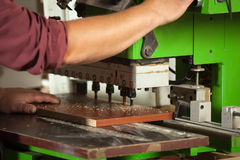 Carpenter working with professional drilling machine closeup. Royalty Free Stock Photo