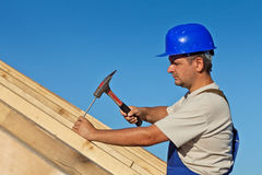 Carpenter working on the roof Stock Images