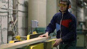 Carpenter working on sawing table in workshop stock footage