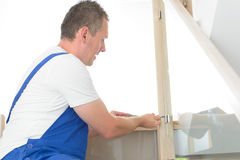 Carpenter. Working with screwdriver on stairs Stock Images