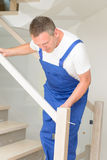 Carpenter. Working  on the stairs Stock Photos
