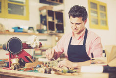 Carpenter working in studio Royalty Free Stock Images