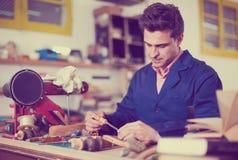 Carpenter working in studio Stock Photo