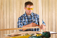 Carpenter working at table Royalty Free Stock Photo