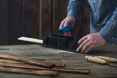 Carpenter working with tools on wooden background royalty free stock images