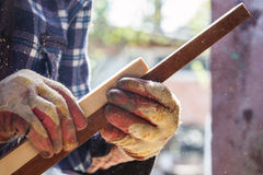 Carpenter working with wood Royalty Free Stock Image