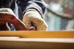 Carpenter working with wood Stock Images