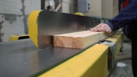 Carpenter working on wood milling machine stock footage