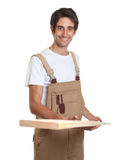 Carpenter working with wooden beam Stock Images