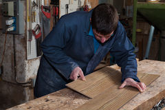 Carpenter working on a Wooden Boards in his Workshop Stock Photos