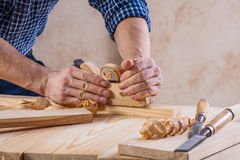 Carpenter working with woodworkers plane very Royalty Free Stock Photography