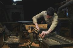 Carpenter Working on Woodworking Machines in Carpentry Shop. Male Hand Clos up. stock images
