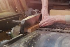 Carpenter Working on Woodworking Machines in Carpentry Shop. Male Hand Close up. royalty free stock photos