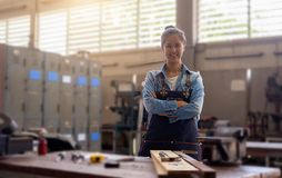 Carpenter on workplace in carpentry workshop. Royalty Free Stock Photos