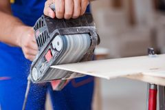 The carpenter working in the workshop Royalty Free Stock Photo