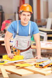 Carpenter working in a workshop Stock Photography