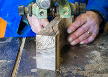 Carpenter workplace- Carpenter workplace. Man using saw to cut wood. Royalty Free Stock Photos
