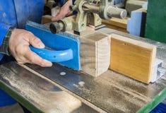 Carpenter workplace- Carpenter workplace. Man using saw to cut wood. Carpenter workplace- Carpenter workplace. Man using saw to cut wood Stock Photos