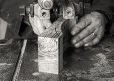 Carpenter workplace- Carpenter workplace. Man using saw to cut wood. Stock Images