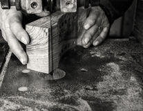 Carpenter workplace- Carpenter workplace. Man using saw to cut wood. Royalty Free Stock Images