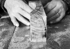 Carpenter workplace- Carpenter workplace. Man using saw to cut wood. Carpenter workplace- Carpenter workplace. Man using saw to cut wood black and white Royalty Free Stock Photo