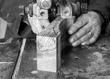 Carpenter workplace- Carpenter workplace. Man using saw to cut wood. Carpenter workplace- Carpenter workplace. Man using saw to cut wood black and white Royalty Free Stock Images