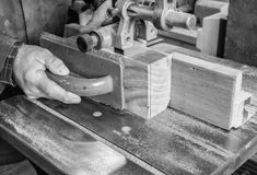 Carpenter workplace- Carpenter workplace. Man using saw to cut wood. Carpenter workplace- Carpenter workplace. Man using saw to cut wood, black and white Royalty Free Stock Photography