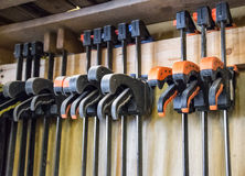 Carpenter workplace- Clamps for Joiners Stock Images