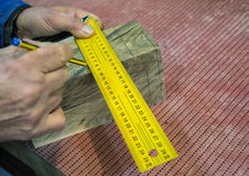 Carpenter workplace- Manuals measurement. On wood royalty free stock photography