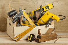 Carpentry concept.Wooden box with carpentry tools on workplace.
